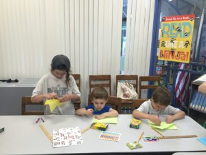 Children making kites at Red Jacket Community Library